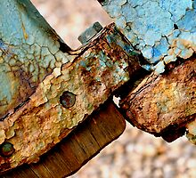 Rusty bolt holding rudder. by Karen  Betts