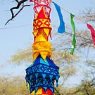 Colorful cylindrical banners hanging from tree at the Surajkund Mela by ashishagarwal74