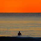 Waiting for the Sun, a lone surfer  by Samantha  Goode