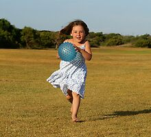 Girl running with ball by Michael Fotheringham Portraits