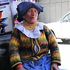 Saleslady At San Francisco Square - Cuenca Ecuador by Al Bourassa