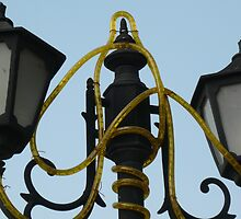 A couple of old lamp posts with the electric wiring by ashishagarwal74