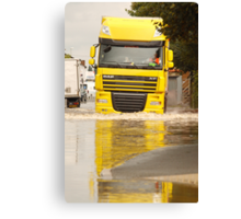 Large DAF articulated lorry driving through summer flash flooding road condition in Britain 2007 Canvas Print