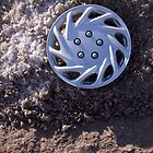 Rule of Three - Lost Hubcap  by valleylilie