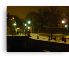 City in Snow and Darkness Canvas Print