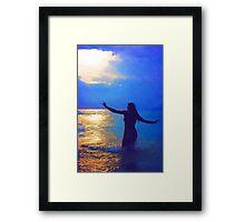 Swimming in the evening ocean Framed Print