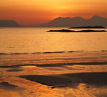 Sunset over Eigg and Rhum. by John Cameron