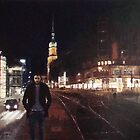Kampstreet with figure and church tower by Franko Camue