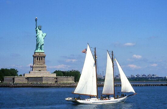 Boat Passing The Statue Of Liberty, Ellis Island, New York Harbour. by Peter Stephenson