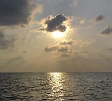 Sun shining from behind a cloud at near sunset off the waters of the Lakshadweep Islands by ashishagarwal74