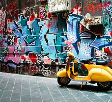Yellow scooter in a Melbourne lane by Alex Howen