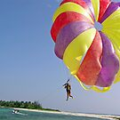 Riding a colorful para-sail behind a speedboat in the Lakshadweep Islands by ashishagarwal74