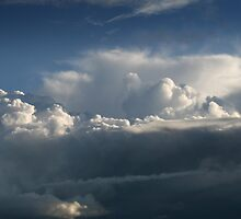Distant storm clouds by SunGlint