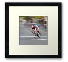 Cyclists Speeding into the Curve Framed Print