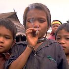 Karen hilltribe children smoking tobacco by John Spies