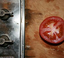 cut tomato on the chopping board by gregorrogerg