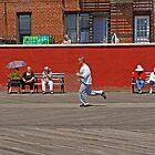 Enjoying Sunshine on a Boardwalk in Brighton Beach, New York by Zal Lazkowicz