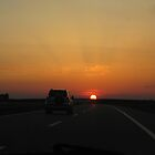 sunset on the highway by Rada
