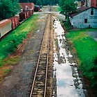 railroad tracks and puddles by Alex Eldridge
