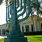 Giant green Menora in front of a Synagogue in Weston,Florida by Zal Lazkowicz