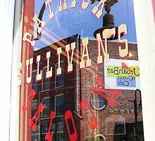 Reflection in window of Patrick Sullivans saloon by raindancerwoman