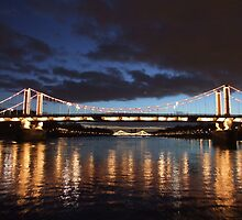 Chelsea Bridge at Night in London, UK by pcimages