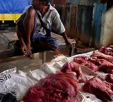 Meat for sale by Mario Soares Ferreira by Friends  of Suai
