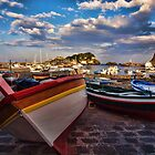 Boats  at the port of Acitrezza, Sicily by Andrea Rapisarda