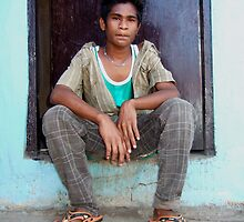 Young man at markets by Moises Diaz Barreto by Friends  of Suai