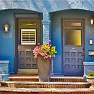 Duplex Entrance Decorated with Flowers in Planters by Gerda Grice