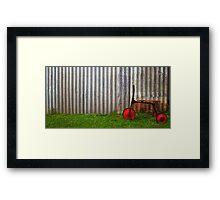 Red trike reminiscing of simpler times... Framed Print
