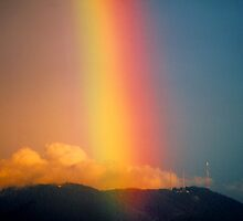 Rainbow over Mount Dandenong, Victoria, Australia. by Ern Mainka