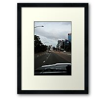 Driving in The City Framed Print