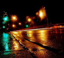 wet highway by Adam Scarf
