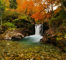 waterfall over riberot river in autumn by patrick pichard