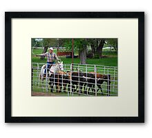 Herding the Steer Back to the Pen Framed Print