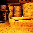 Old abandoned village house attic with vintage woven baskets by exaltedshrimp