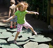 Girl Jumping on Lily Pads by andymars