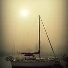 foggy sailboat by Brandi  Sims
