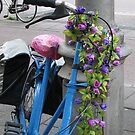Flowered bicycle in blue by Hans Bax