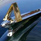 """What do I belong to!? """"Larry, I cheated and googled 1951 Hudson Hornet, – it's a series 7A, thus the gold A on the hood ornament.""""  Solved by Scott Hendricks.. by Larry Llewellyn"""