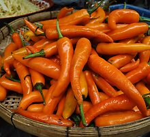 Orange Chilies by Dave Lloyd