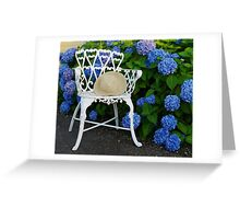 Straw hat, blue Hydrangeas and a Patio chair Greeting Card