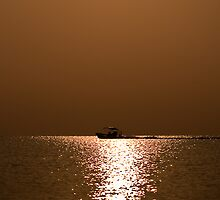 Fly-fishing boat leaving in to the sunrise.  by Karel Kuran