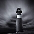 Lighthouse at the Dutch Coast by Joel Tjintjelaar