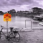 Ringbuoy and bicycle by celticpics