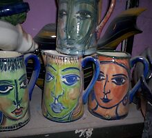 face jugs hiding in the shed by catherine walker