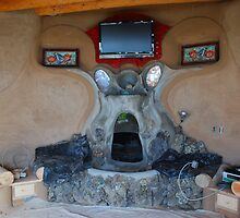 Earthship fireplace by CjbPhotography