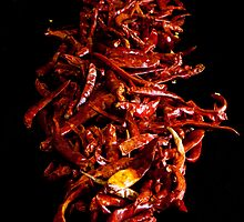 Dried Chili On Black by Dave Lloyd