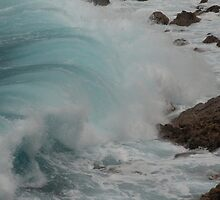 Wave crashing. by Hannah Fenton-Williams
